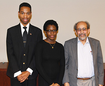 First-place winners Joshua Patterson and Destiny Davis pose with Dr. Mazen Shahin, director of the University's AMP Program