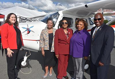Rep. Debra Heffernan, Dr. Devona Williams, Drt. Wilma Mishoe, Rep. Stephanie Bolden and Lt. Col Michael Hales with new plane.
