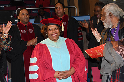 Dr. Wilma Mishoe receives a standing ovation as she enters the theatre for the Investiture Ceremony.