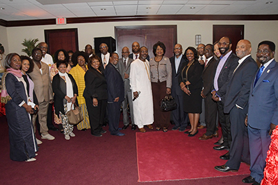 Attendees of the Pan African Conference's VIP Reception gather for a group photo.