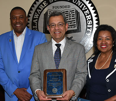 Jose Echeverri (center) received Board's Enterprise Risk Management Award.