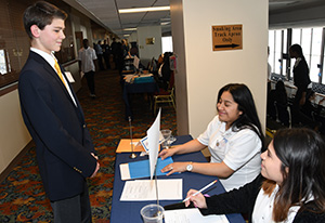 University student Karla Moreno and Itzel Braca-Morales check in a BPA competitor during the conference.