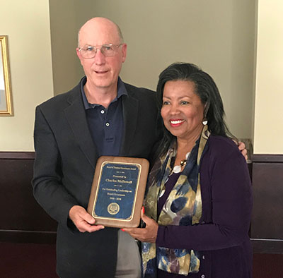 Charles McDowell (l) receives the Board's Governance Award from Bd. Chair Devona Williams.