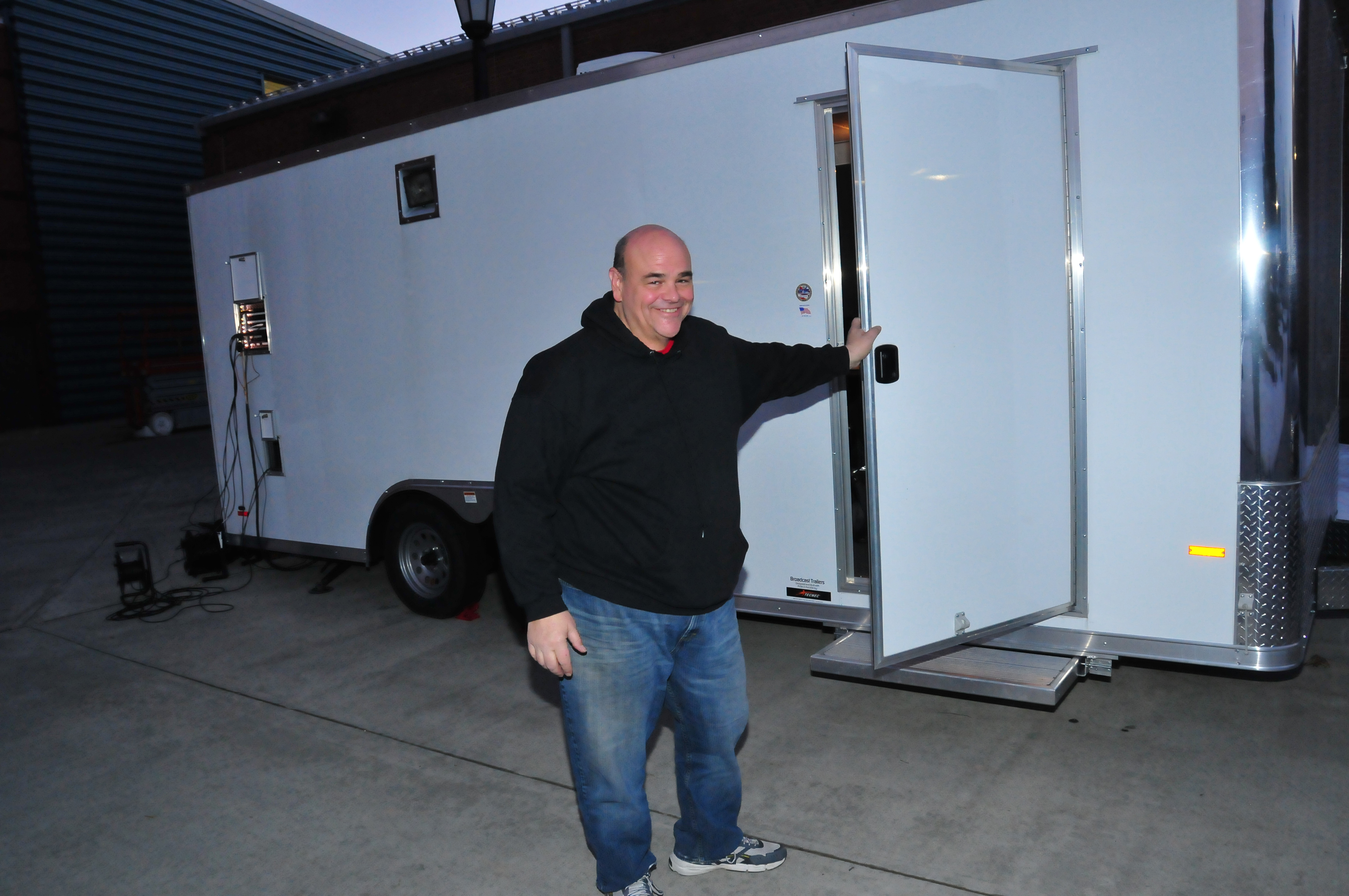 "Vince ""Chelli"" Ciammaichelli, Mass Comm technology director, stands outside of the Mobile Video Production Trailer."