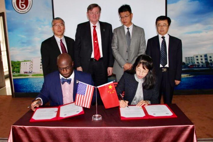 DSU Provost Tony Allen (seated left) sign a MOU agreement with Chanchung Normal University officials.