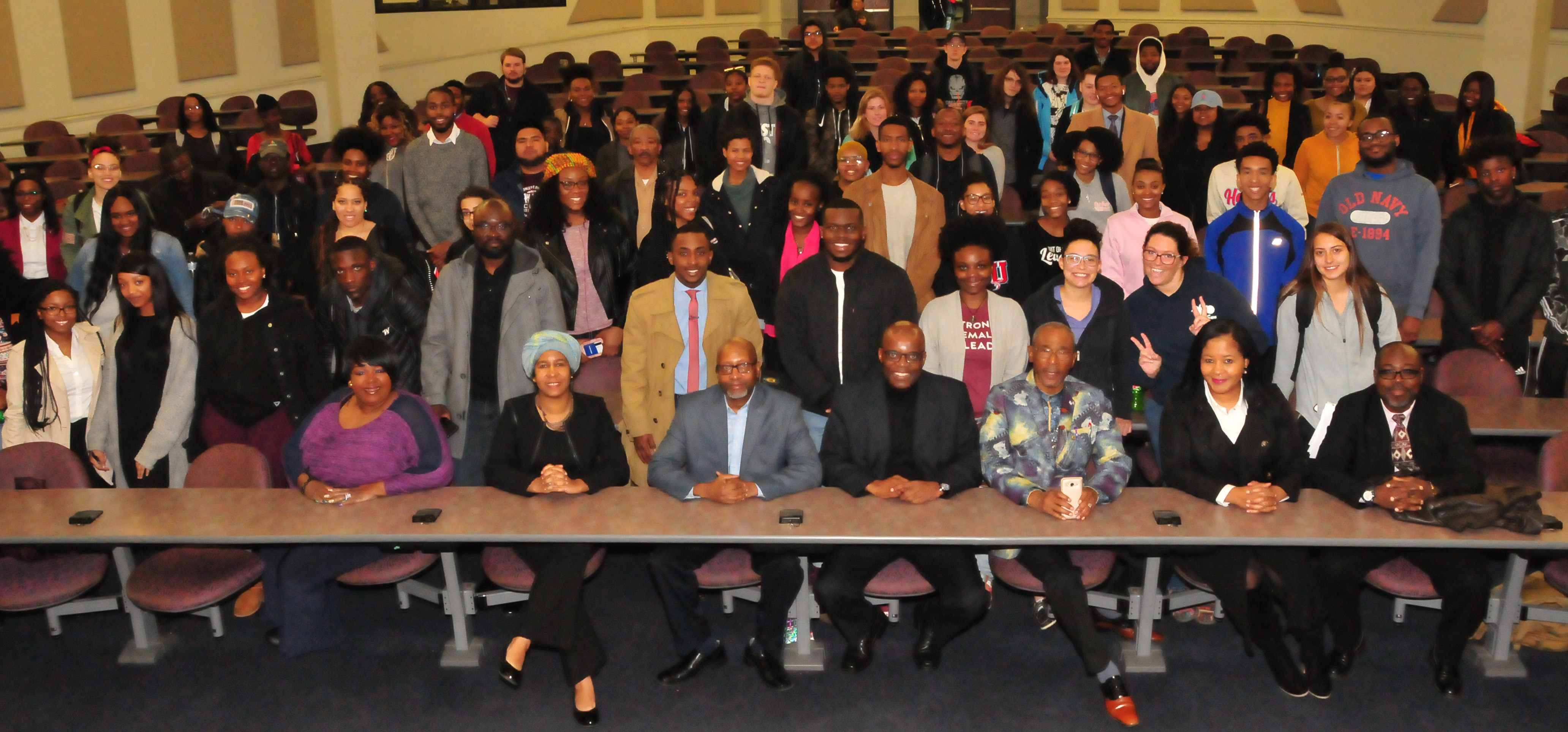 Dr. Eddy Maloka (seated center in dark suit) poses with the students who were his audience.