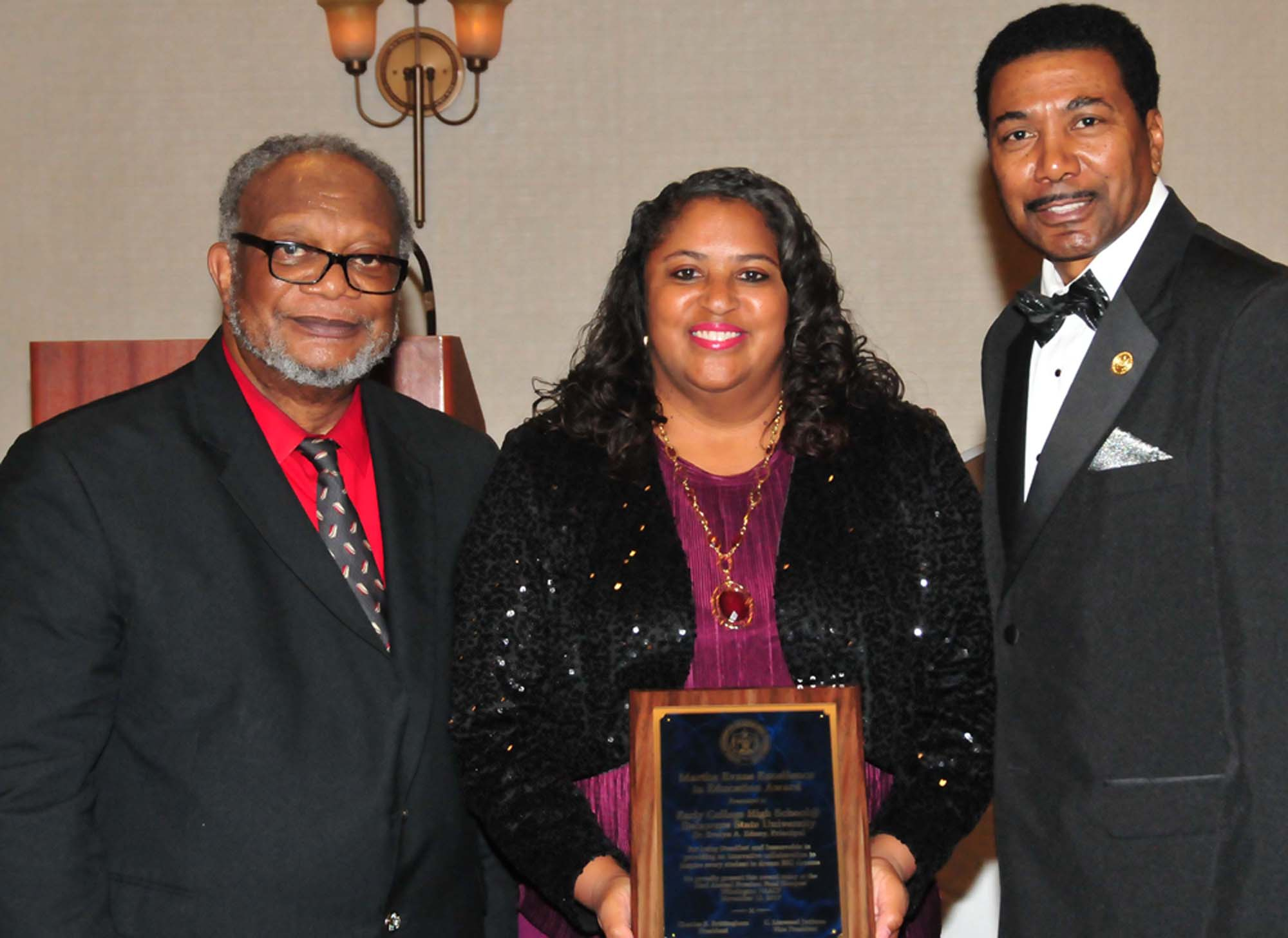Dr. Evelyn Edney (center), director of the Early College HS, accept the award from the NAACP.