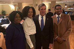 (L-r) Rep. Stephanie Bolden, Nikela Roderique, Gov. John Carney and Tarik Jackson pose at the Black Caucus event.
