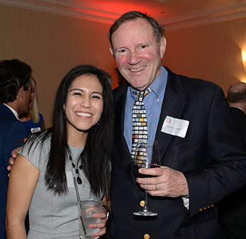Indira Islas poses with Donald Graham at the ceremony with Donald Graham, the Opportunity Scholarship founder.
