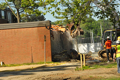 The demolition began on May 24 by tearing down the former TV room of Laws Hall.