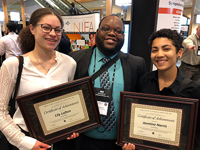 Lily Lofton (l) -- 3rd place Oral Presentation; Jasmine Harris (r) -- 1st place Poster Presentation; with Dr. Kwame Matthews.