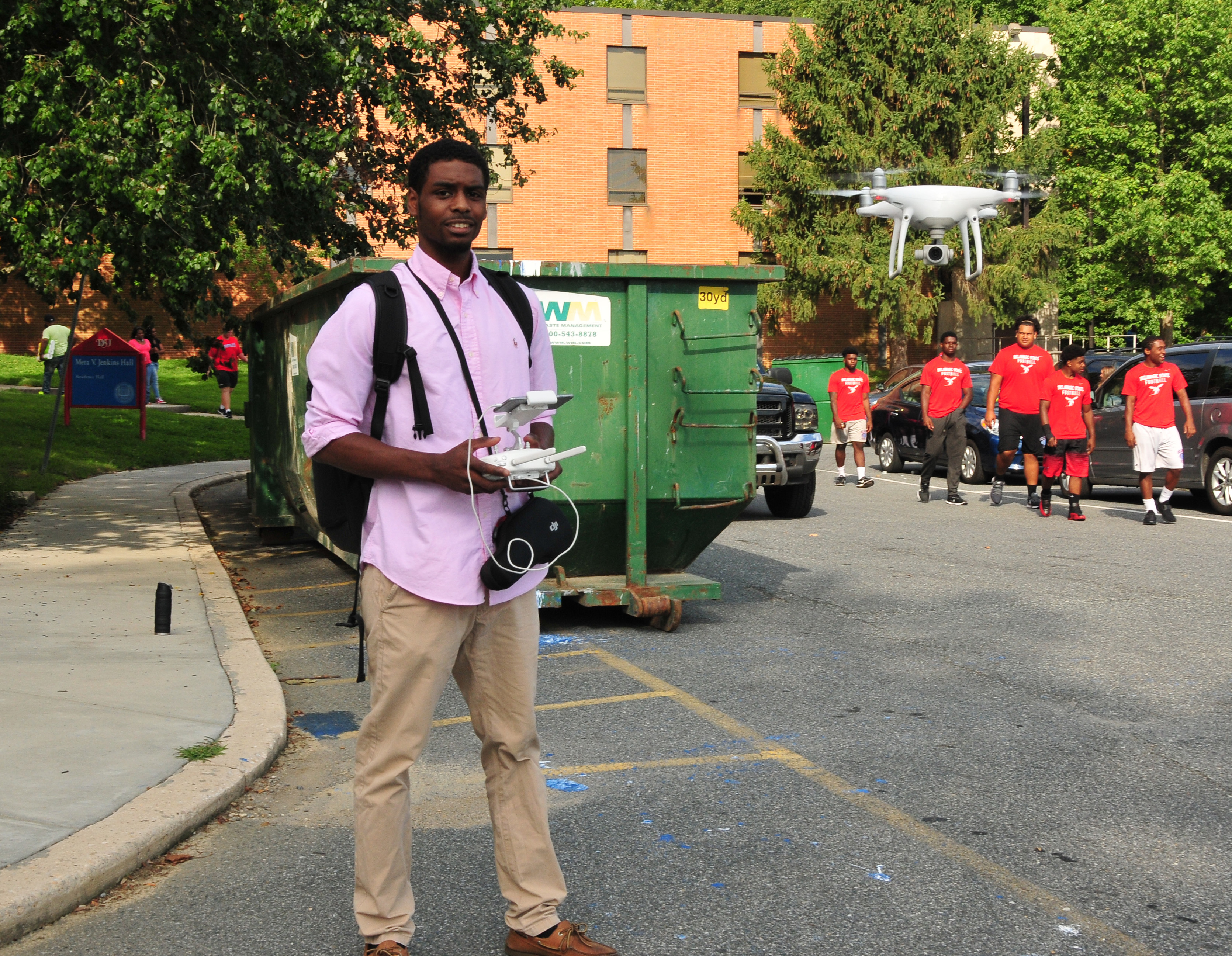 Rashaun Bosley flies his drone to get footage of the residential hall move-in activity in August.