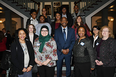 Rep. Nnamdi Chukwuocha poses at Legislative Hall with visiting University students and faculty.