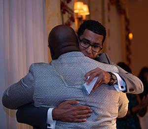 Dr. Tony Allen shares a congratulatory hug from Wali Rushdan II, attorney and award presenter.