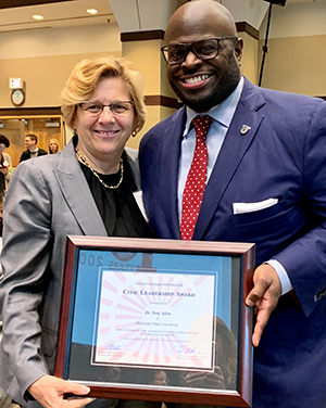 University Provost Tony Allen holds his Civic Leadership Award with Dr. Roberta Cordano, president of Gallaudet University.