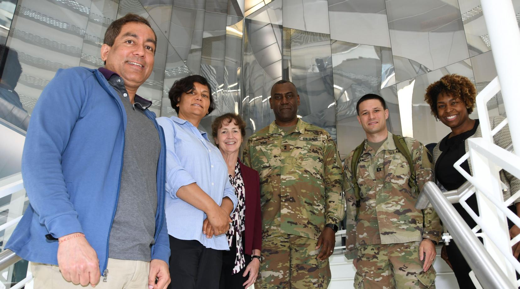(L-r) DSU's Dr. Gour Pati, Dr. Renu Tripathi, Dr. Melissa Harrington with Maj. Gen. Cedric Wins, commanding general of the U.S. Army Research Development Engineering Command, along with his staff Capt. Joshua Blanc and Dr. Patrice Collins, who earned her Ph.D. at DSU.