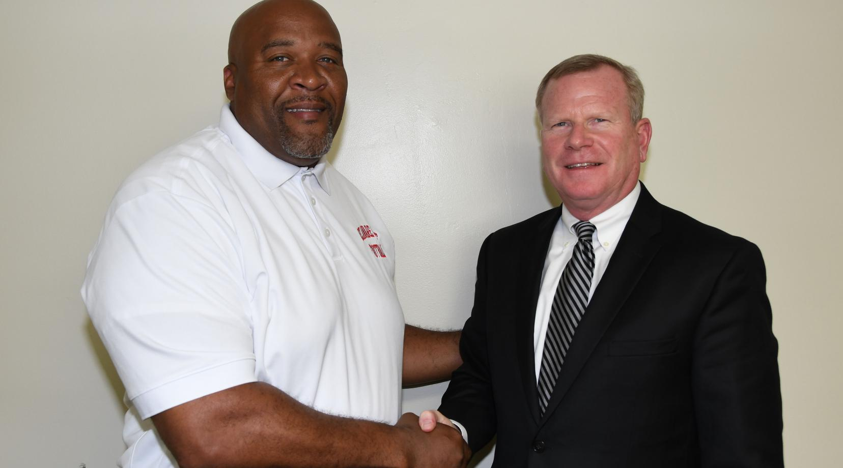DSU Head Football Coach Rod Milstead welcomes his new boss (r) Dr. D. Scott Gines, who has been newly named the University's Athletic Director.