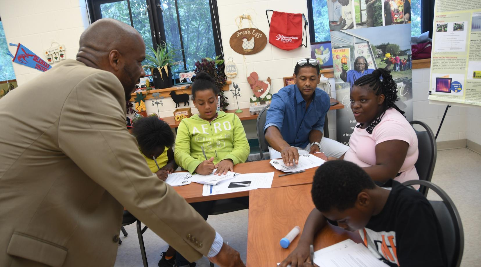 <p>Dr. Michael Casson, DSU associate professor of accounting, teaches Kingswood Community Center youth about the finer points of entrepreneurshp.</p>