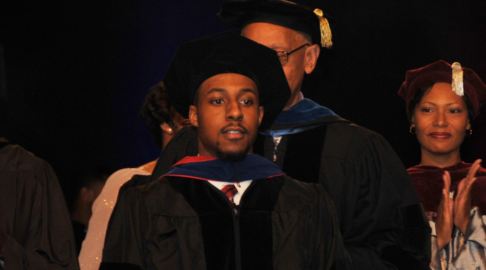 <p>Dr. Jalaal Hayes -- shown in December 2015 when he became the youngest ever Ph.D. graduate in DSU history -- is now being honored as the Top Influential Chemist of the Year by the International Association of Top Professionals.</p>