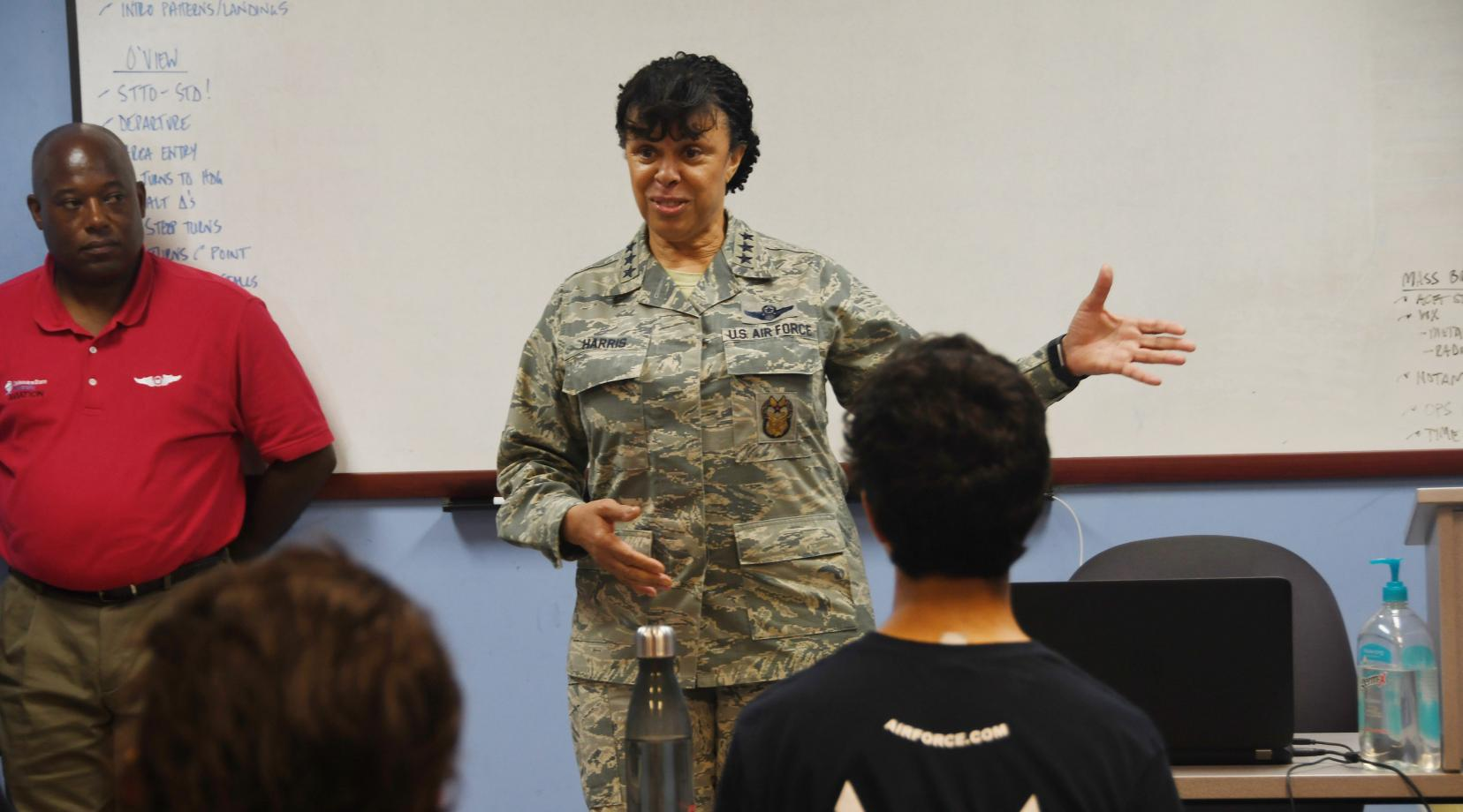 <p>Lt. Gen. Stayce Harris, the highest ranking African-American femaie pilot in the U.S. Air Force, speaks to a group of ACE Program trainees at the Delaware Airpark, site of the DSU Aviation Program.</p>