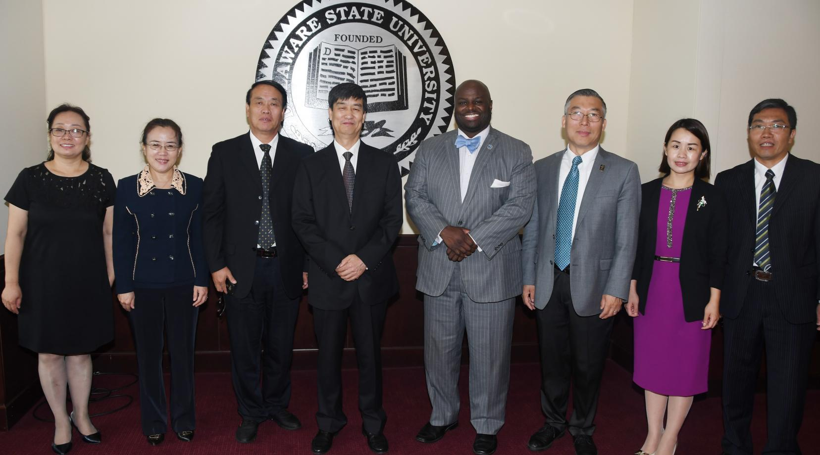 (L-r) Dr. Tian Yi, DU director of DU College of Music; Dr. Zhang Guoqiang, director of DU College of Foreign Languages; Dr. Xu Jing, director of Academic Affairs; Dr. Liu Wenlie, DU chairman; DSU Provost Tony Allen; Dr. Fenghan Liu, DSU associate vice president of International Affairs; Dr. Du Yali, DU director of International Exchange and Cooperation; and Jiao Dejie, DU director of the College of Life Science.