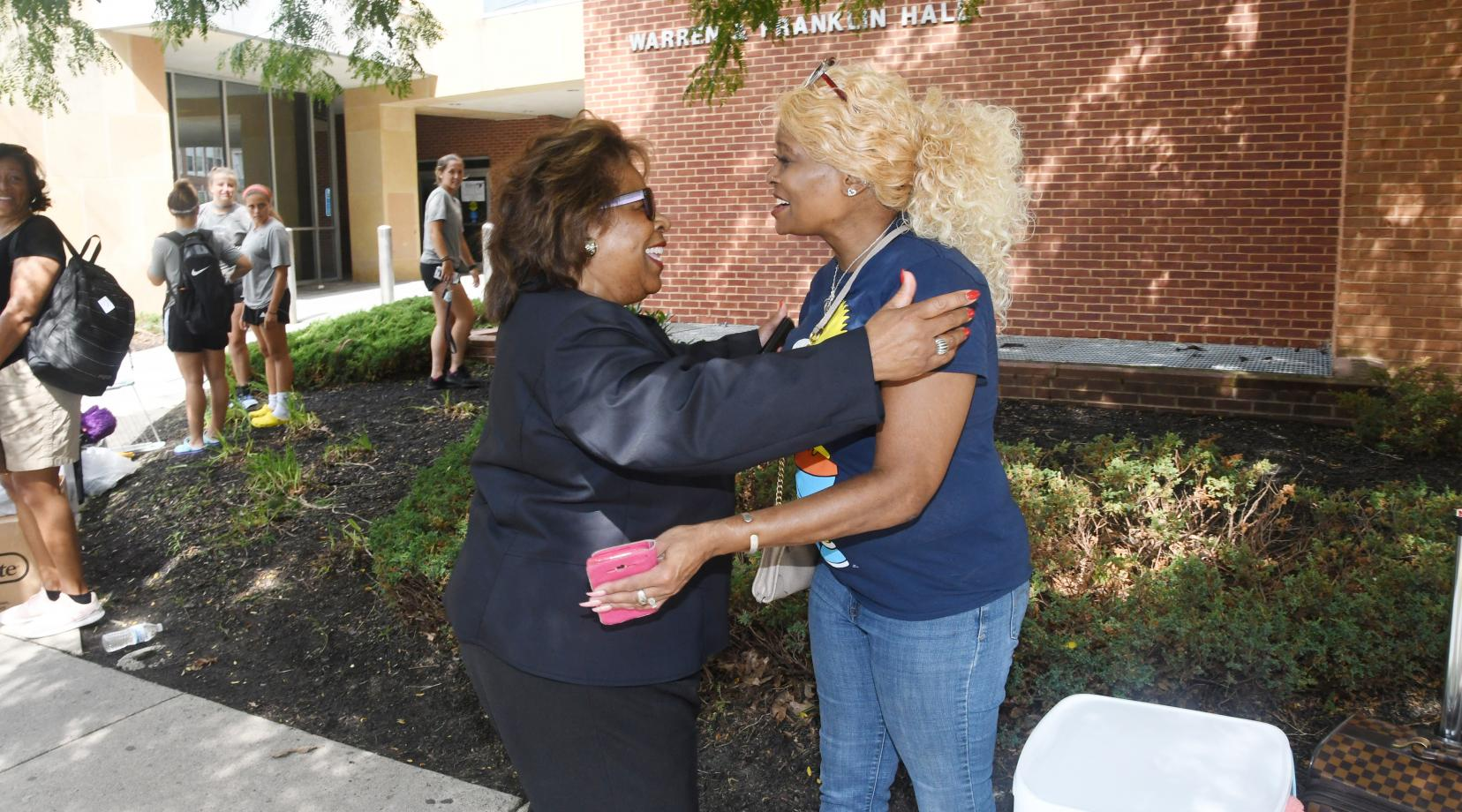 <p>DSU President Wilma Mishoe greets a parent during Move-In Day on Aug. 22 in front of Warren Franklin Residential Hall.</p>