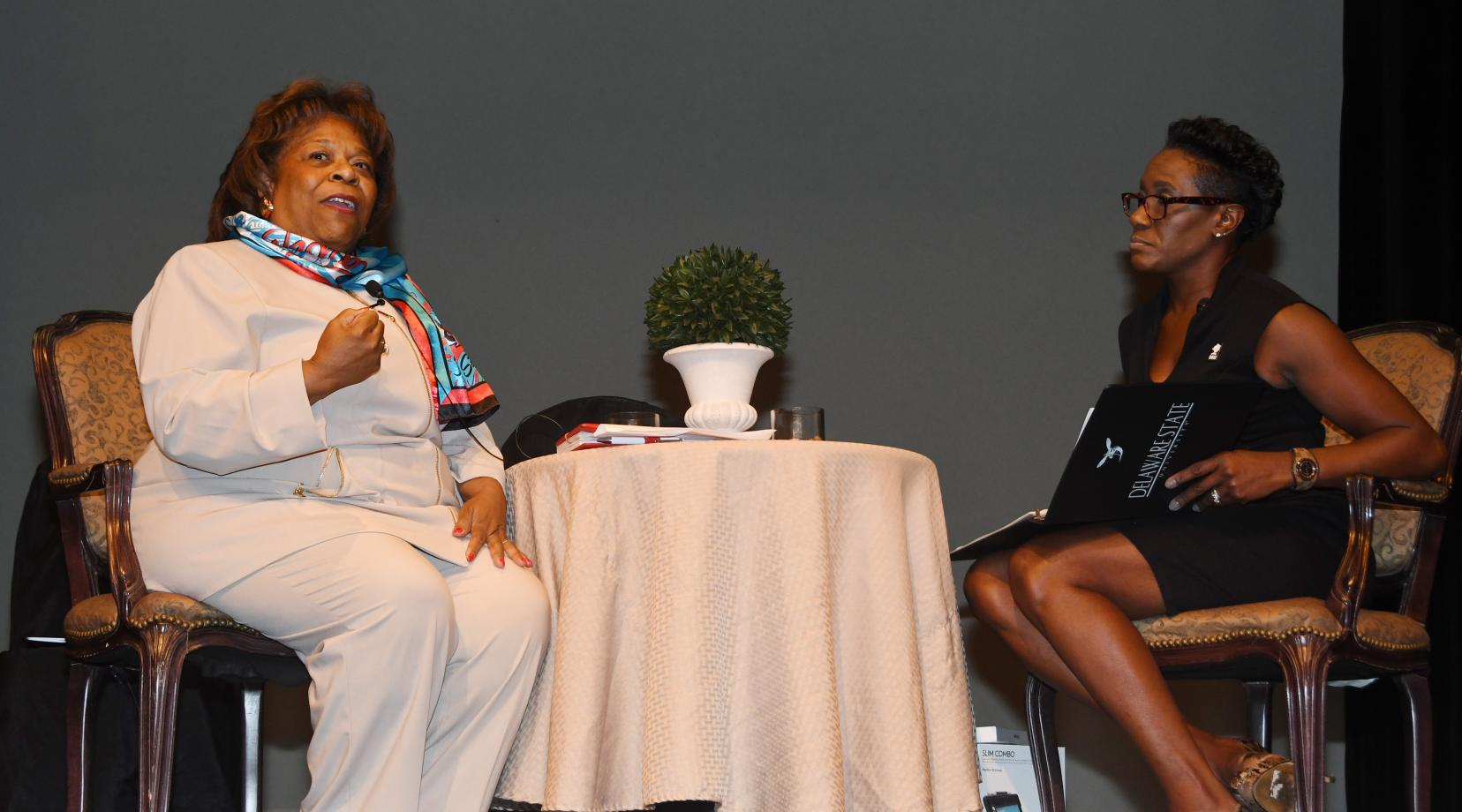 <p>DSU President Wilma Mishoe (L) shares her vision and priorities for the University during the Q&A portion the Faculty Opening Institute, facilitated by Dr. Francine Edwards, dean of the College of Humanities, Education and Social Sciences.</p>