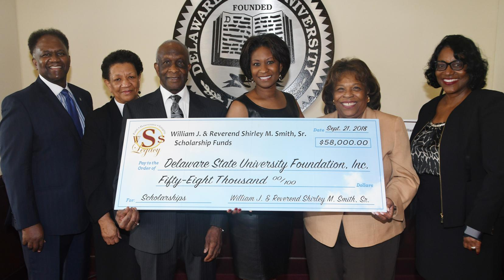 <p>(L-r) H.L. Larry, Rev. Shirley Smith, William J. Smith, S. Renee Smith-Larry, University President Wilma Mishoe, and Dr. Vita Pickrum pose for a photo after the Smiths presented the check to the institution.</p>