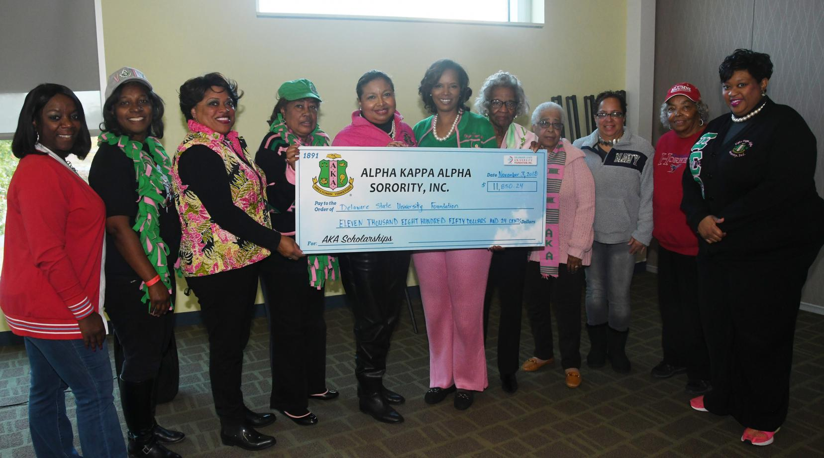Alpha Kappa Alpha members representing Delaware chapters in Wilmington, Newark and Dover, came together to present a scholarship donation of more than $11,850 to the University.