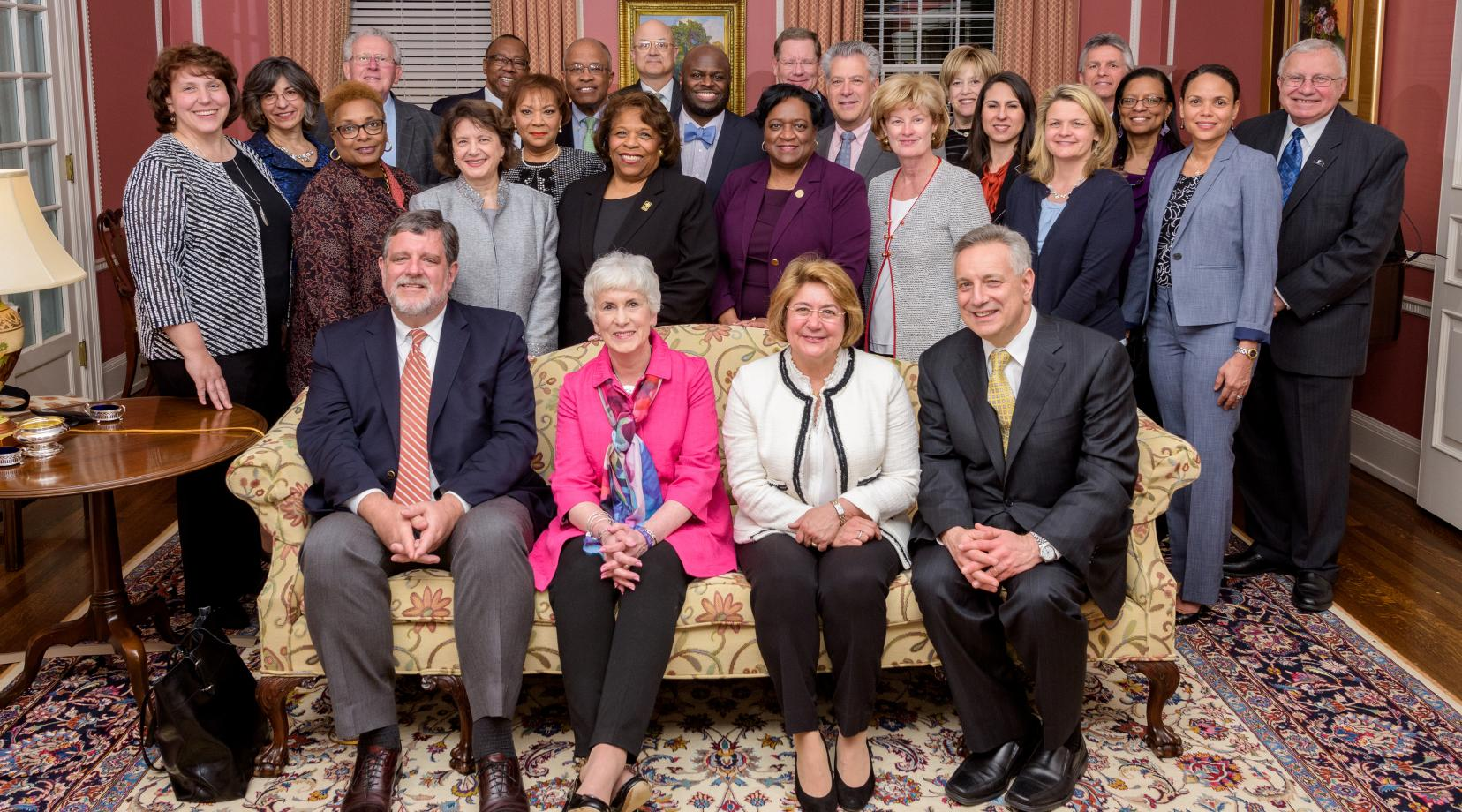 University President Wilma Mishoe and Provost Tony Allen (both in standing center) pose with other presidents and administrators whose institutions are a part of the Campus Compact Mid-Atlantic. During a Nov. 8 ceremony, the Compact presented Dr. Allen with its Civic Leadership Award.