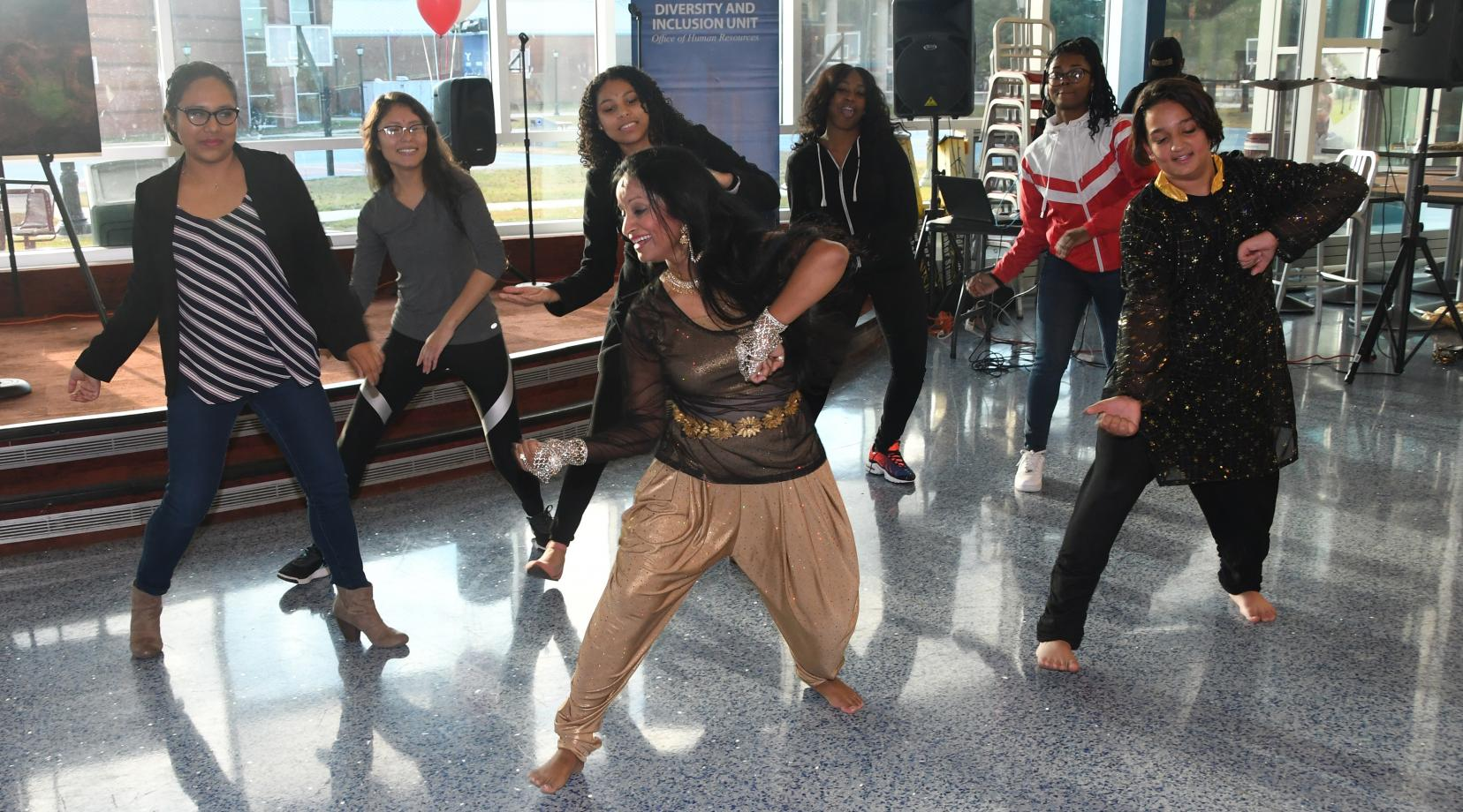 An dancer from Bangladesh teaches some audience participant a dance from her country during the Unity in Diversity event.