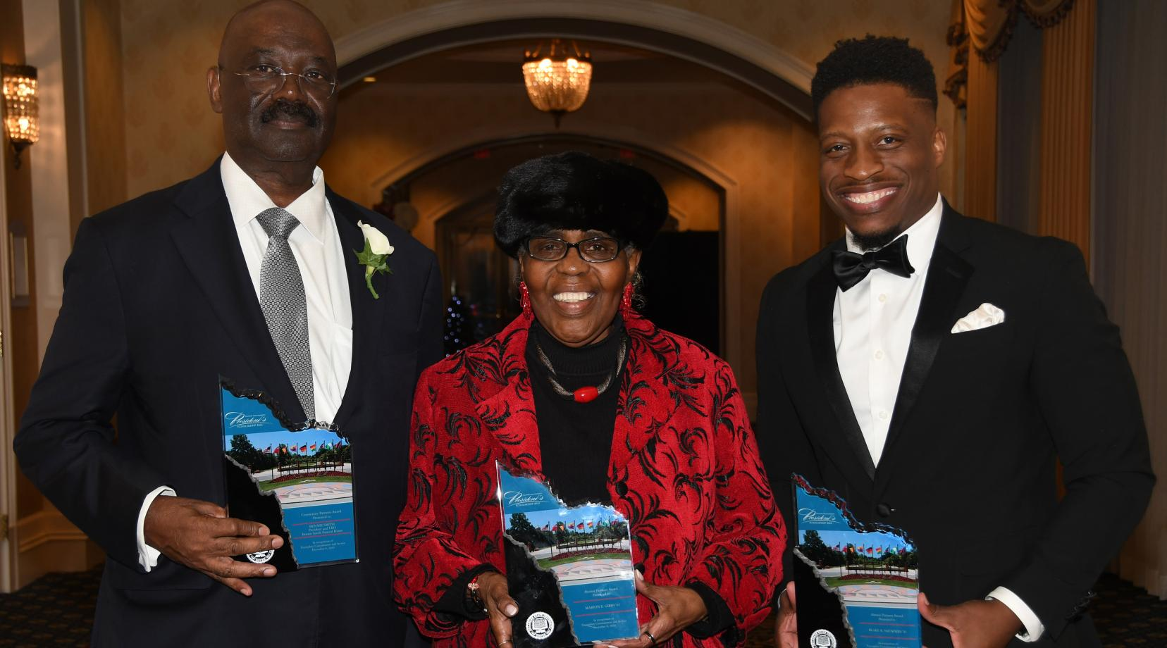 The 2018 President's Scholarship Ball's University Partners Award recipients: (l-r) Bennie Smith, Marion E. Gibbs and Blake R. Saunders.