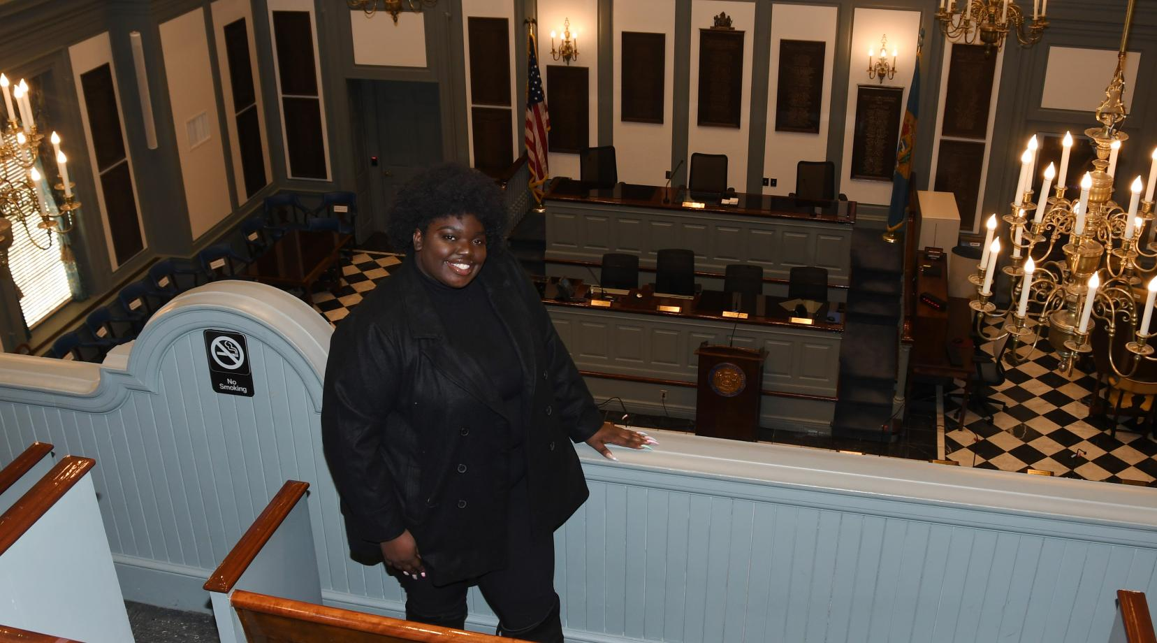 Adriante Carter stands above the Delaware House of Representatives chamber in Legislative Hall in Dover, where she will work represent the University as a Legislative Fellow during her final semester in the spring.