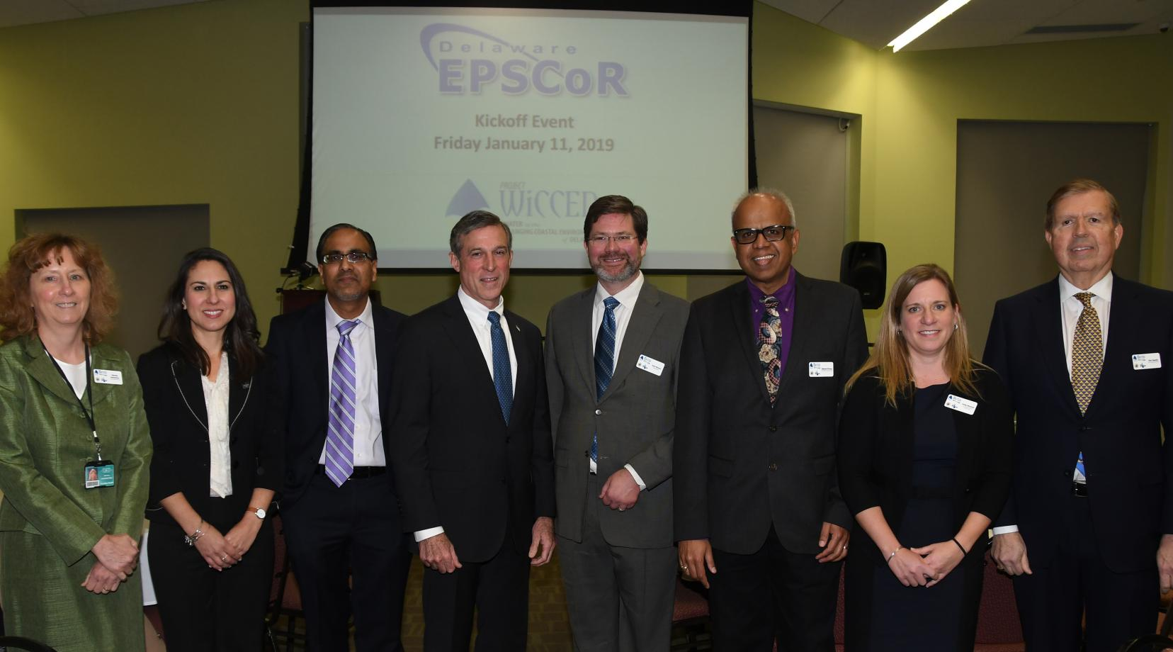 <p>Delaware EPSCoR leadership: (L-r) Martha Hofstetter, DTCC Institutional Lead; Justina Sapna, DTCC VP for Academic Affairs; Venu Kalavacharla, DSU Institutional Lead and Co-PI; Gov. John Carney; Kent Messer, Project Director, and PI; Malcolm D'Souza, Wesley Institutional Lead, and Co-PI; Holly Michael, Research Lead and Co-PI; Donald Sparks, Delaware EPSCoR Director, and Co-PI.</p>
