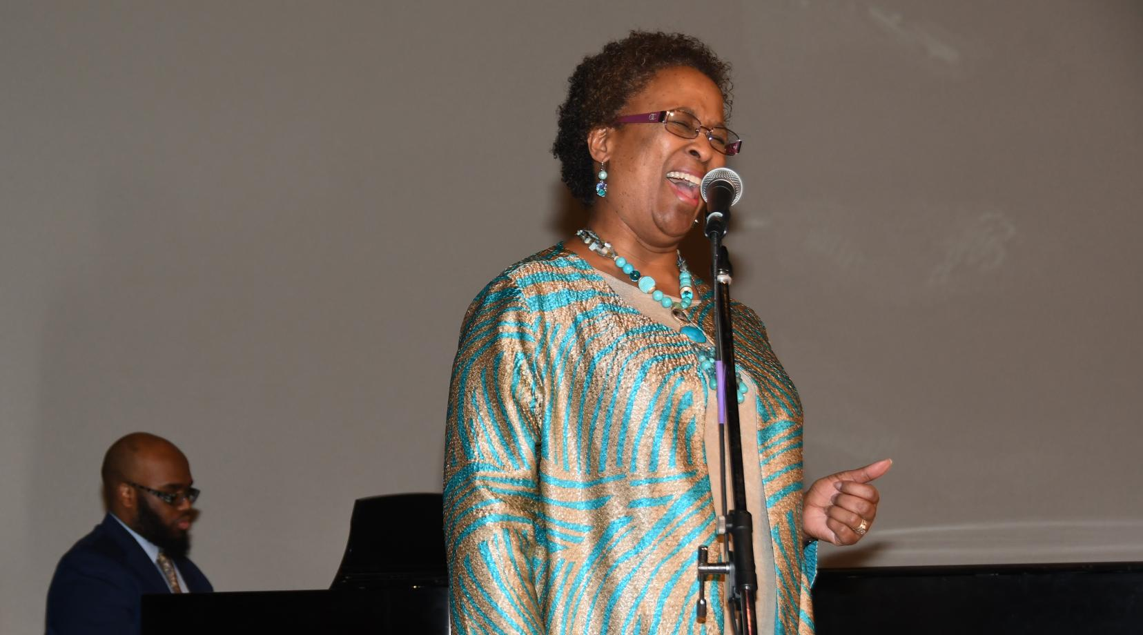 <p>Dr. Marsha Horton, dean of the College of Health and Behavioral Sciences, puts on her music hat metaphorically and sings the National Anthem during the 33rd annual Martin Luther King Jr. National Holiday Program on campus. Photos by Judlin Pierre</p>