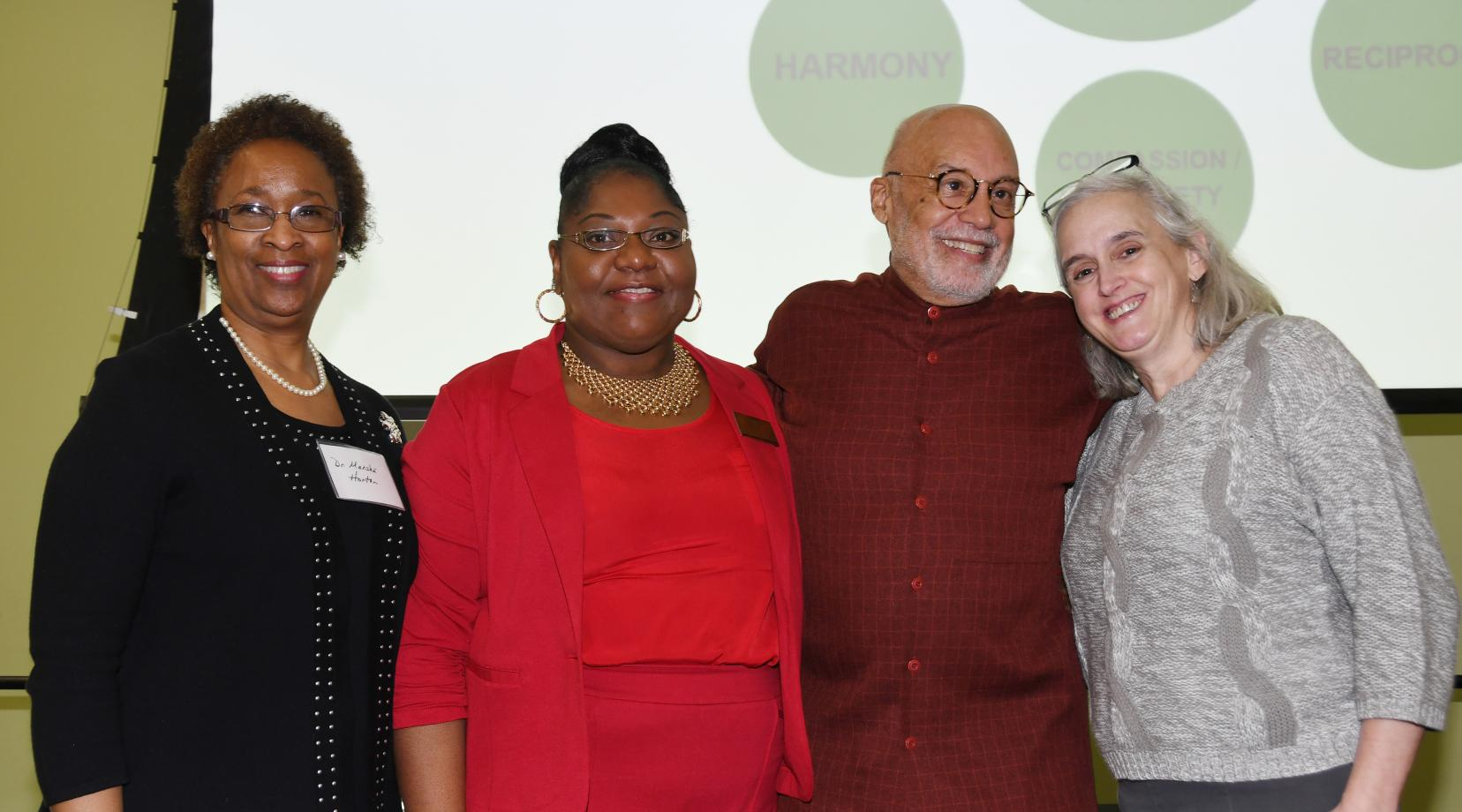 "(L-r) Dr. Marsha Horton, dean of the College of Health & Behavioral Sciences, Dr. Gwen Scott-Jones, chair of the Dept. of Psychology, keynote speaker Aminifu R. Harvey, and Del. First Lady Tracey Carney, pose during a Feb. 14 conference entitled ""Shifting from Trauma Informed Care to an African Healing Centered Approach."""
