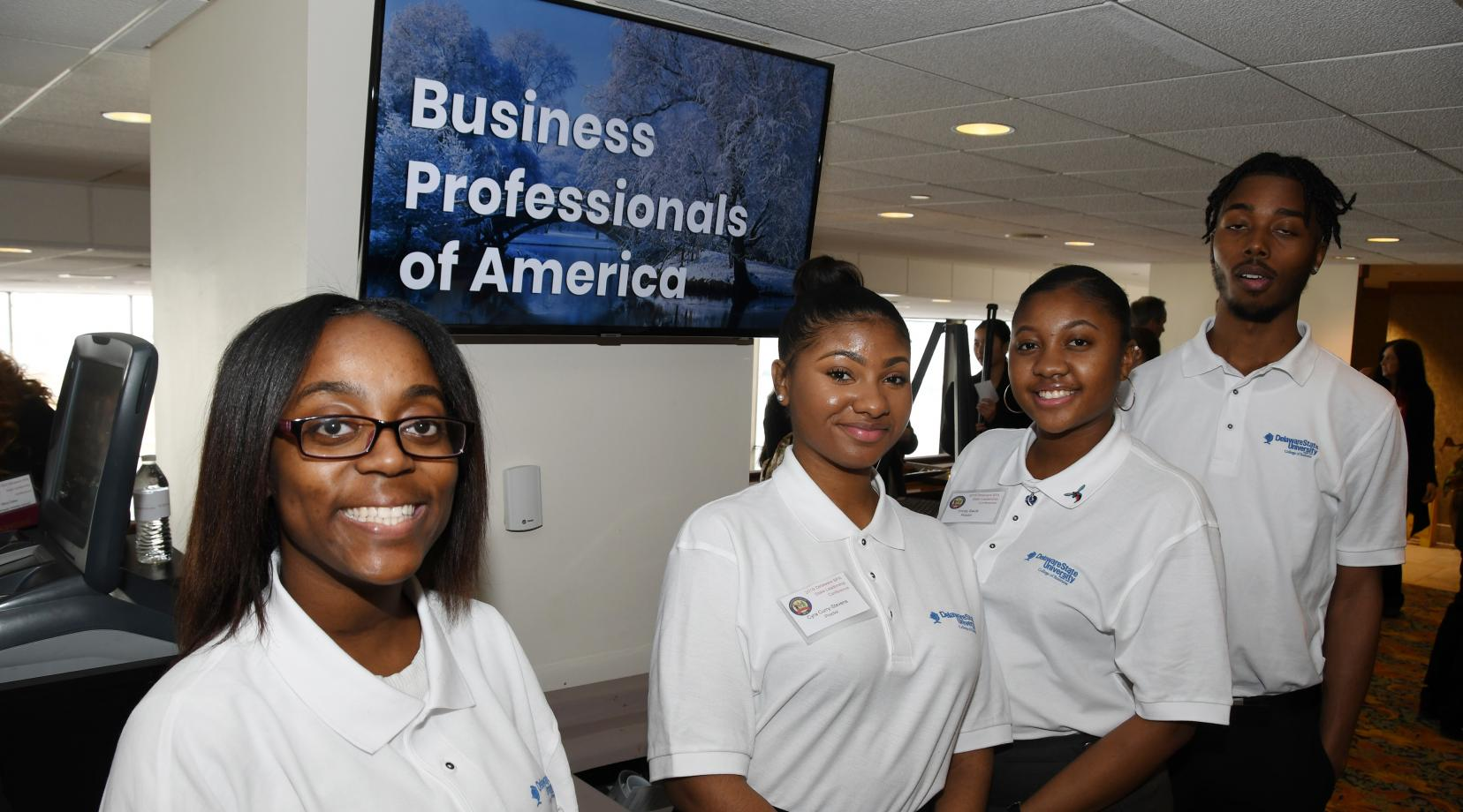 <p>(L-r) University students Charlyeshia Jones, Trinity Savis, Tyra Curry-Stevens and Marvin Hagwood were among the 90 Delaware State University students who volunteered as proctors for the Delaware Business Professionals of America Leadership Conference held at Dover Downs Hotel and Casino Feb. 26-27.</p>
