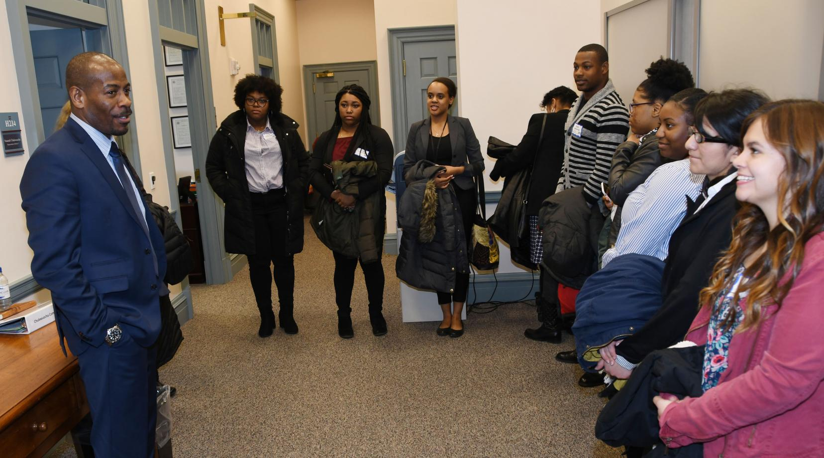 Rep. Nnamdi Chukwuocha, a University alumnus, speaks to a group of DSU social work students outside of his office at Legislative Hall.