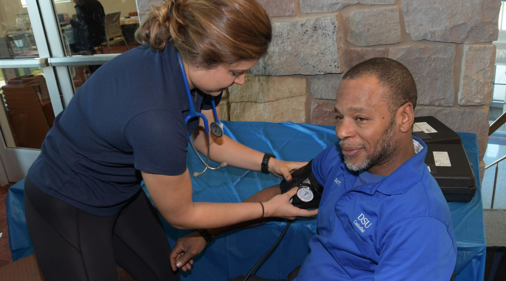 <p>One of DSU valued custodian Arron Brown takes a break to get his blood pressure check during the activities at the Public Health and Fitness Leaders&#039; Day in the MLK Jr. Student Center.</p>