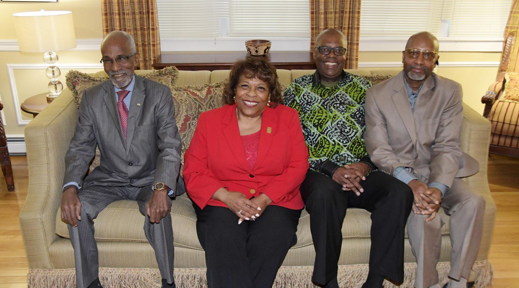 (L-r) APRM Minister Khayar Oumar Defallah, University President Wilma Mishoe, APRM CEO Dr. Eddy Maloka, and Center for Global Africa's Ezrah Aharone, pose together during a April 9 reception at the President's Residence.