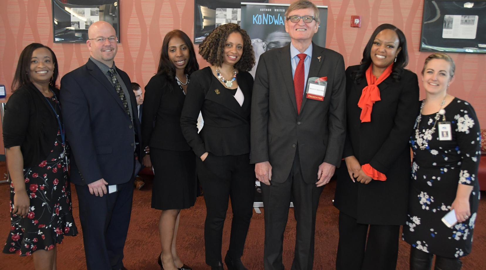 <p>DOE&#039;s Tiffany Cireen Jon Nembauer, Raushawn, Shelly Rouser, retired University Associate Provost Bradley Skelcher and Education Department Chair Shelley Rouser, DOE&#039;s Monique Martin and Shannon Holston gather for a photo during the summit.</p>