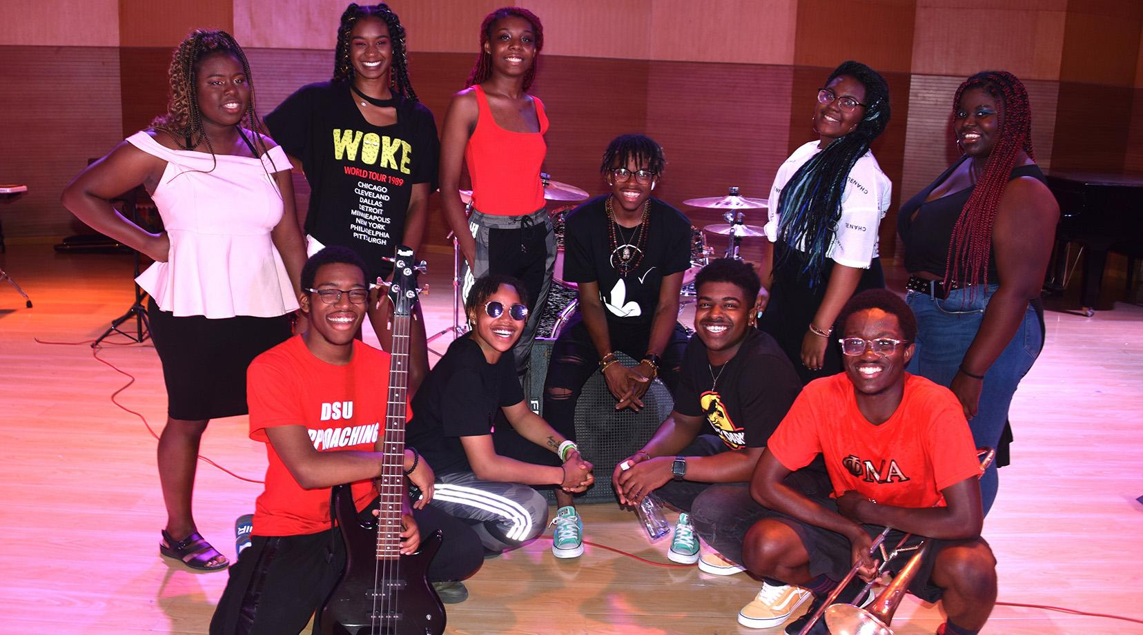 Members of the DSU Popular Music Ensemble are: (kneeling l-r) Kamin Clark, Imani Sulleman, Issachar Scroggins and Glamu Kpov; (standing l-r) Chloe Humphrey, Aishah Bradley, Beauty Marsh, Davyn Parham, Nireh Traylor and Mozella Matthews.