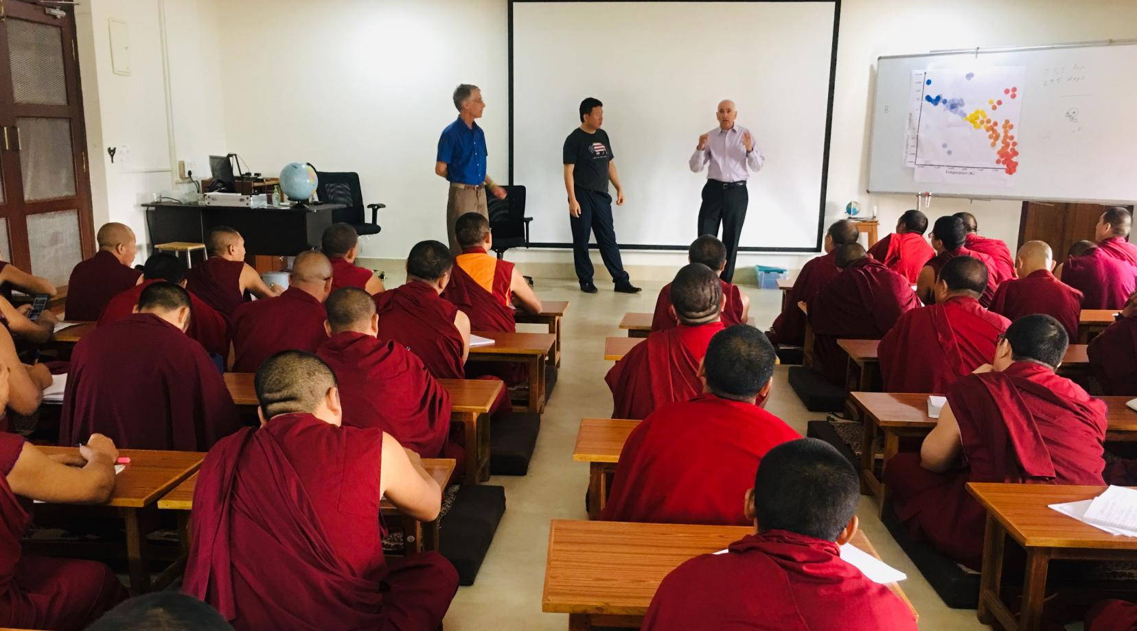 Dr. Matthew Bobrowsky, director of the DSU Observatory and Science Outreach, teaches astronomy to a group of about 70 Tibetan monks during a recent trip to India.