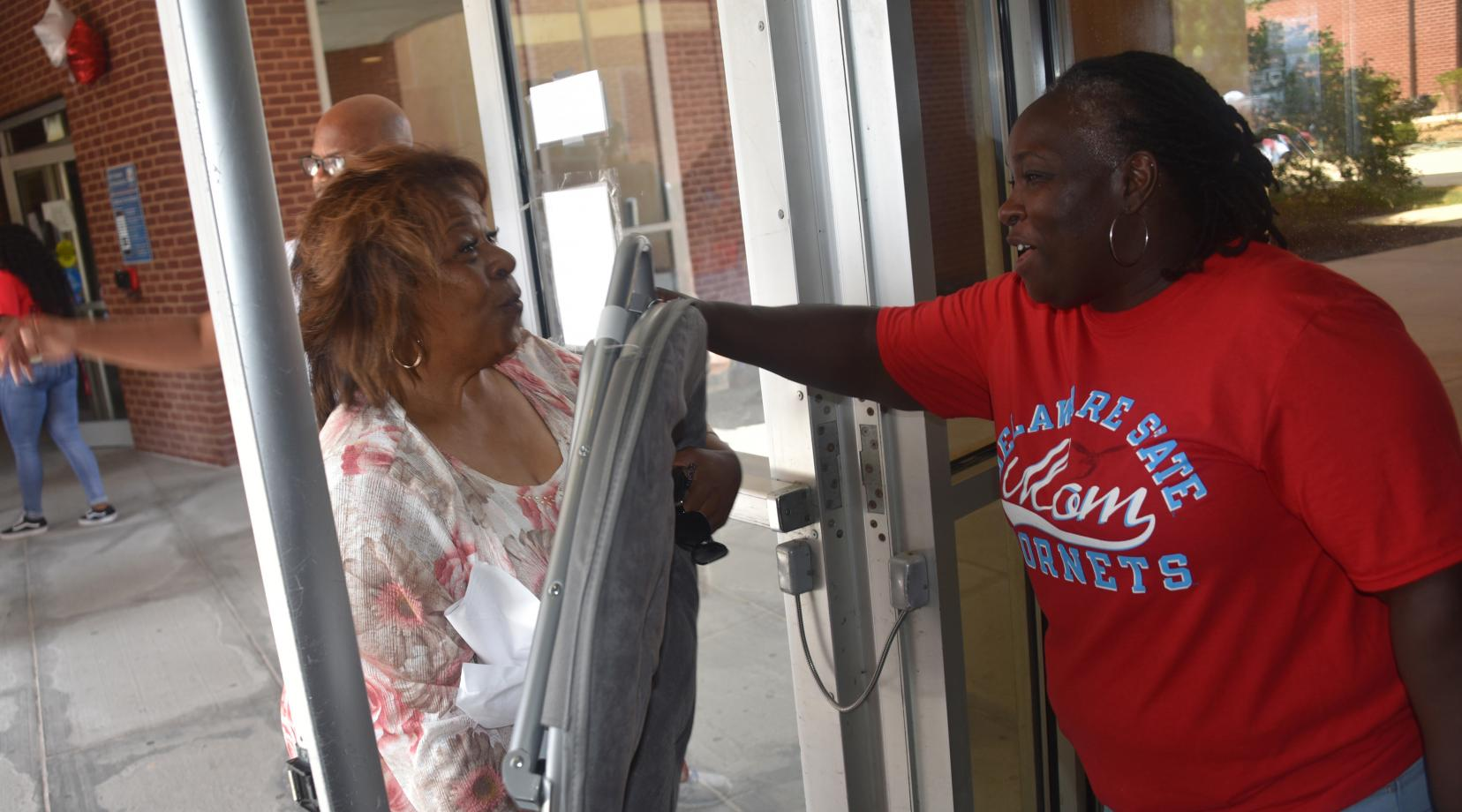 University President Wilma Mishoe even got into the volunteer work of helping students and the families move their belongings into the residential halls.