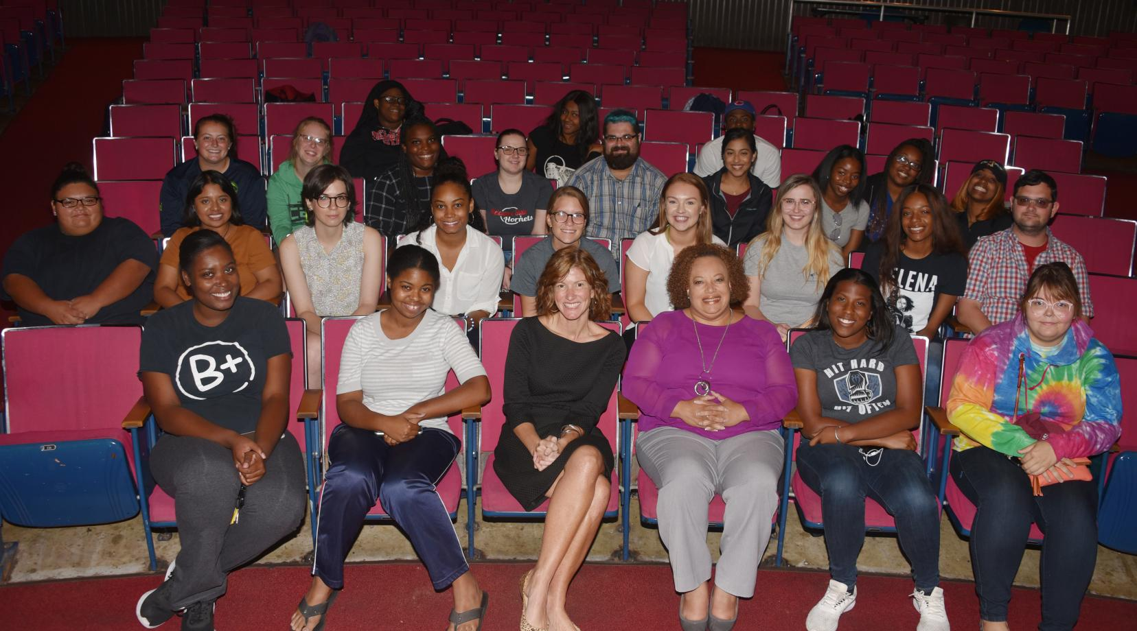 <p>Dana Bowe (center front, black dress), 2019 Delaware Teacher of the Year, seated next to Dr. Crystal Timmons, director of Clinical and Field Experiences, poses with the education majors she shared her teaching experiences with on Sept. 25 in the Education and Humanities Theatre.</p>