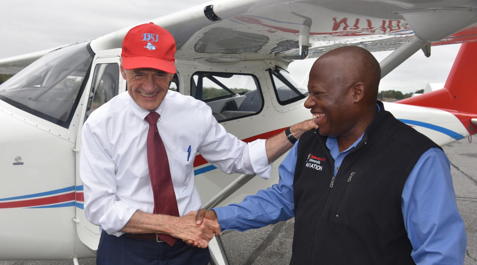 <p>U.S. Sen. Tom Carper shakes hands with Lt. Col. Michael Hales, director of the University&#039;s Aviation Program, after the elected official flew one of the new planes recently acquired by Del State. Sen. Carper is a former naval aviator.</p>