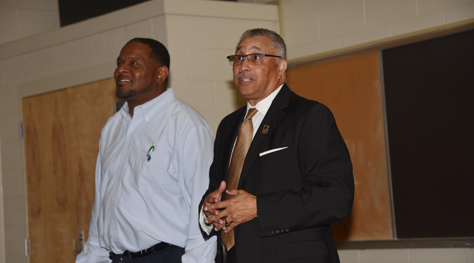 <p>Herman Woods, the new Associate Vice President of Facilities Management, Planning and Construction, introduces himself to the custodial staff as Bernard Pratt, Senior Director of Plant Maintenance stands alongside.</p>