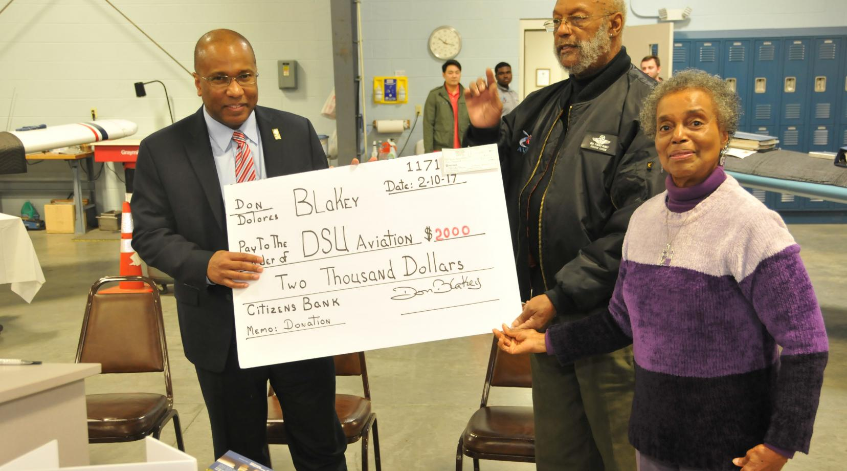 DSU President Harry L. Williams accept a check from Dr. Donald Blakey and his wife Dolores as a kick-off contribution for the newly launched Friends of the DSU Aviation Program fundraising campaign.