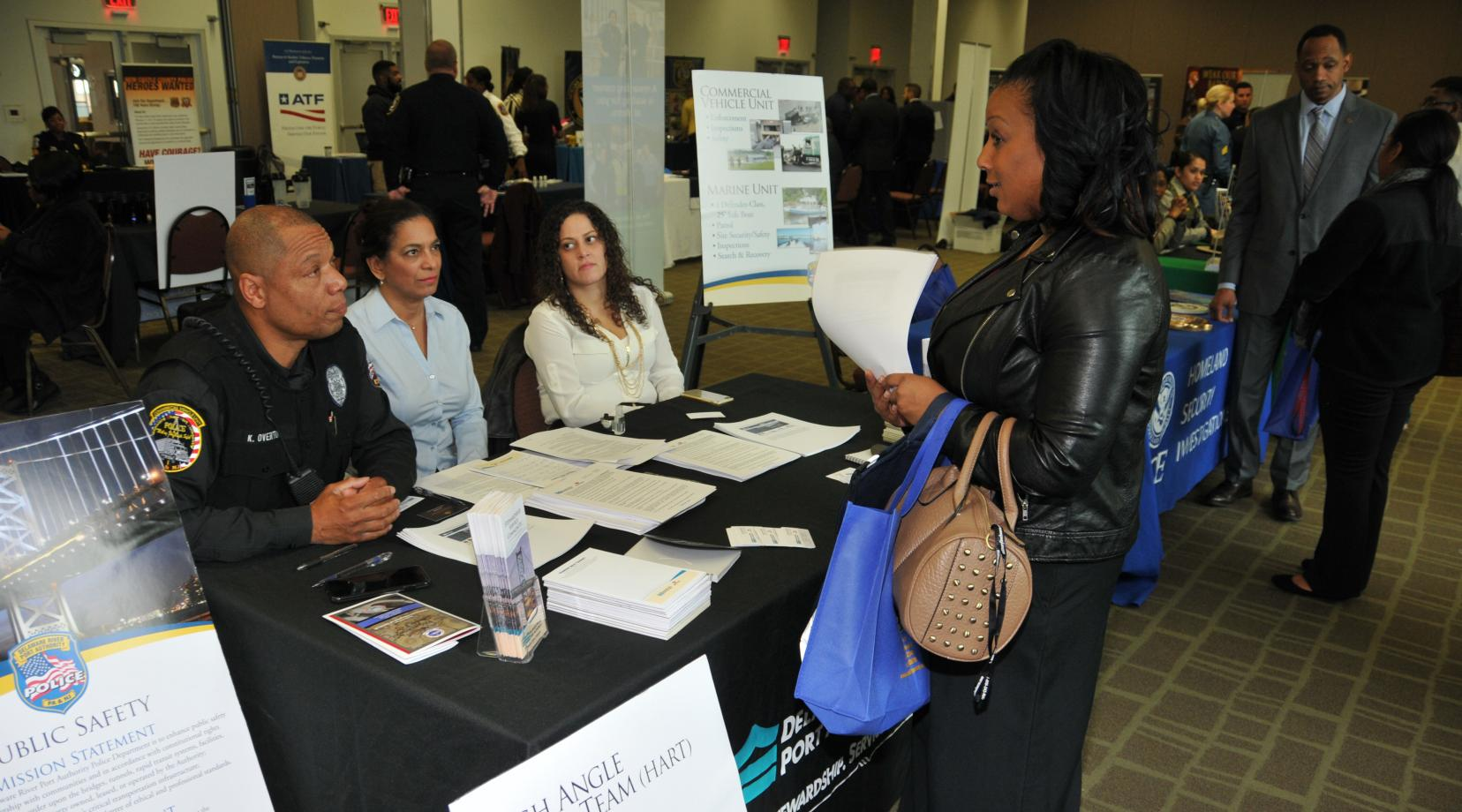 <p>An attendee of the NOBLE Career Fair get some information from the Delaware River and Port Authority representatives.</p>