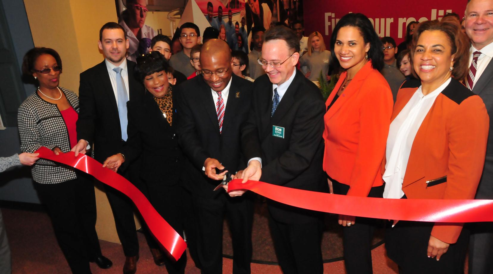 <p>Participating in the ribbon cutting of the new Delaware State University section of the Junior Achievement Financial Bank in Wilmington are: (l-r) Dr. Marshá Horton, dean of the DSU College of Education, Health and Public Policy; Bryan P. Gordon, deputy chief of staff for Lt. Gov.; state Rep. Stephanie T. Bolden; DSU President Harry L. Williams; Robert Eppes, president of Junior Achievement of Delaware; Dr. Kara Odom Walker, Secretary of Delaware Health and Social Services; Valerie Dinkins, special asst. to the DSU president; and Michael Carney, JA development director</p>